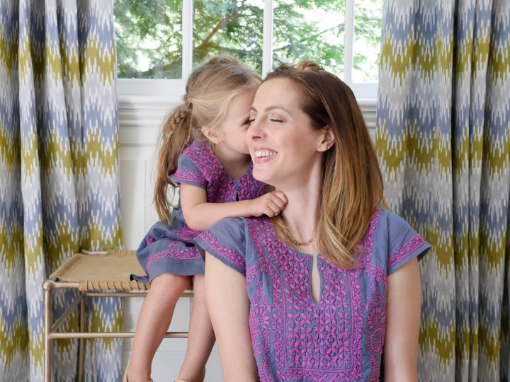Marlowe Martino whispers a secret in to her Mom's ear