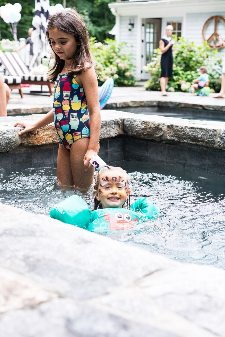 Marlowe Martino swims with friends in the hot tub at her third birthday party