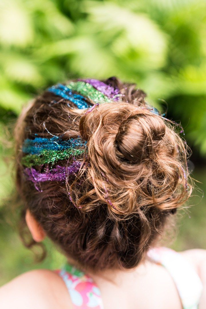 Party guests get glitter in their hair at the mermaid braid bar at Marlowe Martino's third birthday party