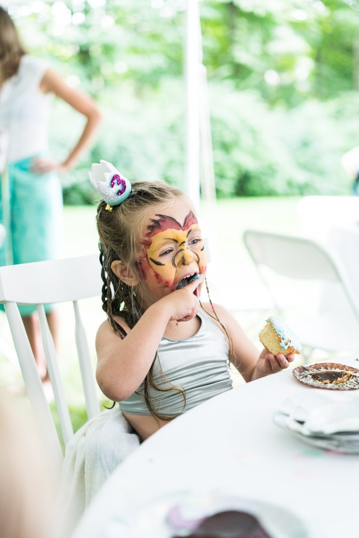 Marlowe Martino digs in to a birthday cupcake at her third birthday party