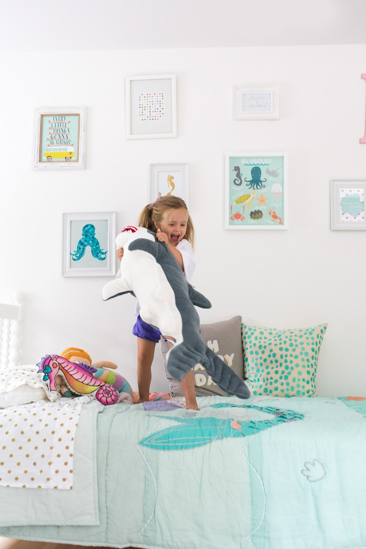 Marlowe Martino jumps on her Big Girl Bed by Incy Interiors in her mermaid themed room