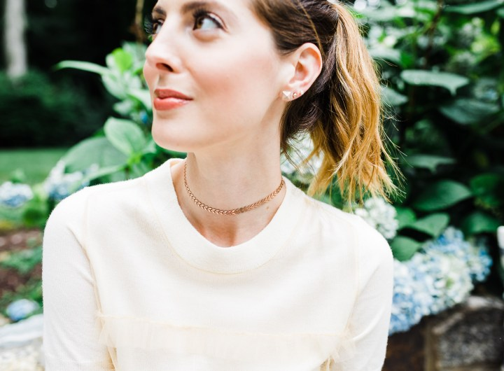 Eva Amurri Martino wears a champagne colored sweater top and a gold Argento Vivo choker