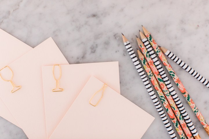 Details of Eva Amurri Martino's Rosé tasting party, including cute patterned pencils and pads of pink paper to take notes!