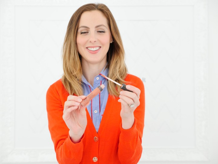 Eva Amurri Martino applies a nude lipgloss as part of her monthly obessions roundup