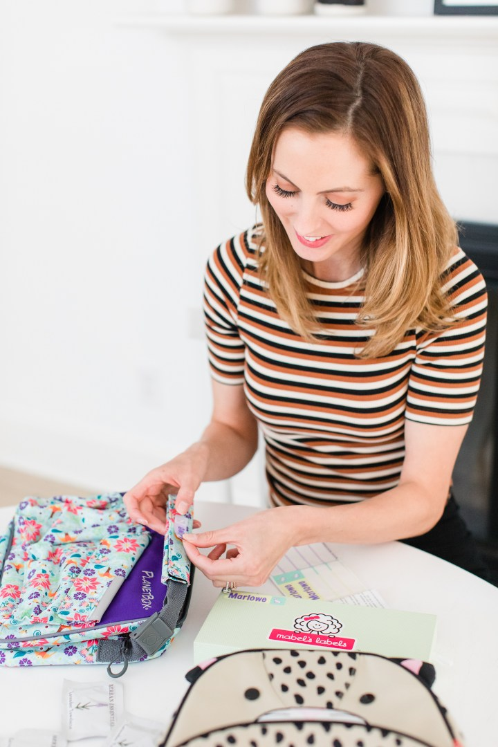 Eva Amurri Martino puts a label on daughter Marlowe's lunchbox to prepare her for preschool