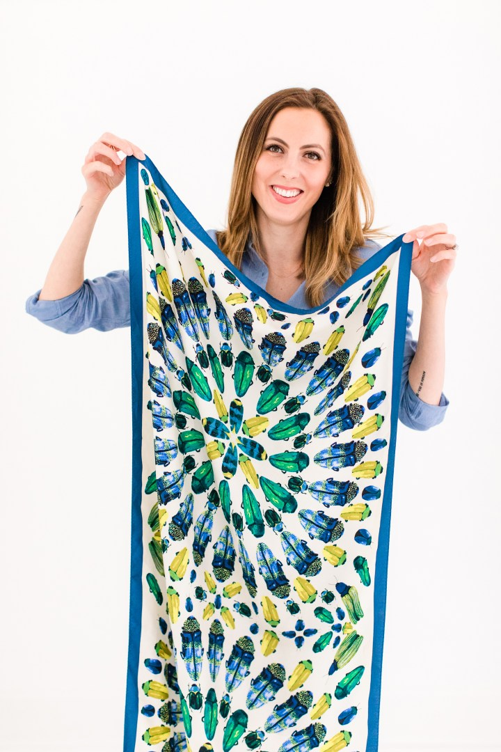 Eva Amurri Martino holds up a printed silk tory burch scarf