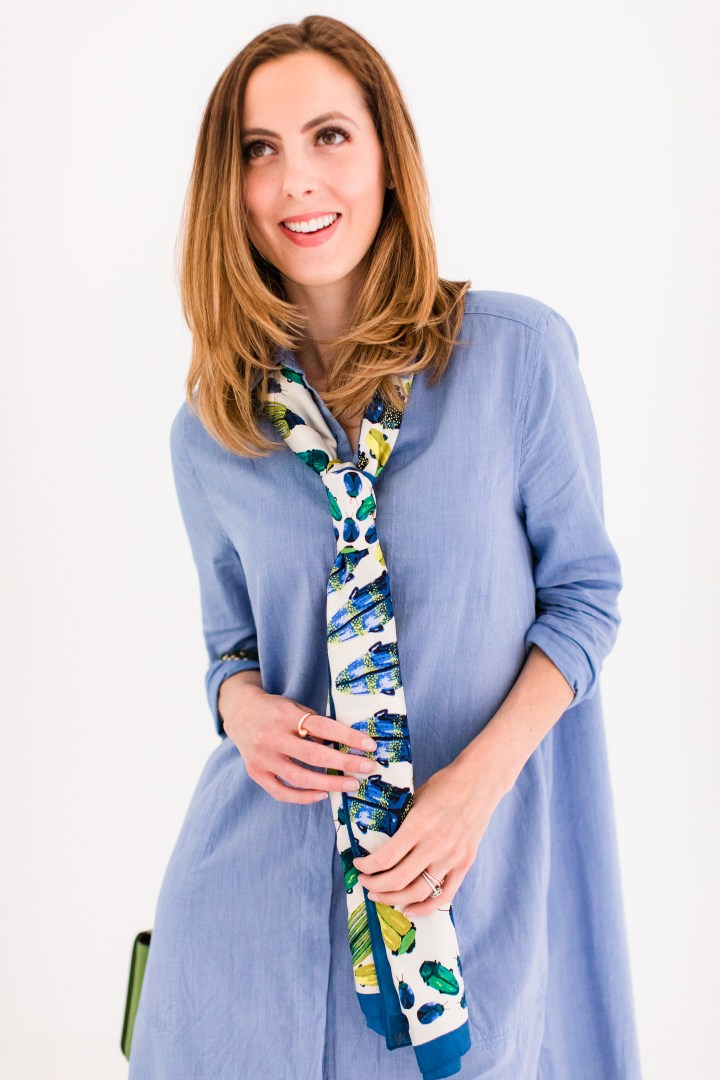 Eva Amurri Martino wears a long skinny silk scarf tied around her neck in a necktie knot and paired with a shirt dress
