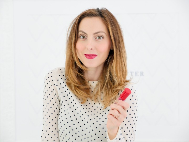 Eva Amurri Martino wears a white sweater with black polka dots, and a shiny berry lip
