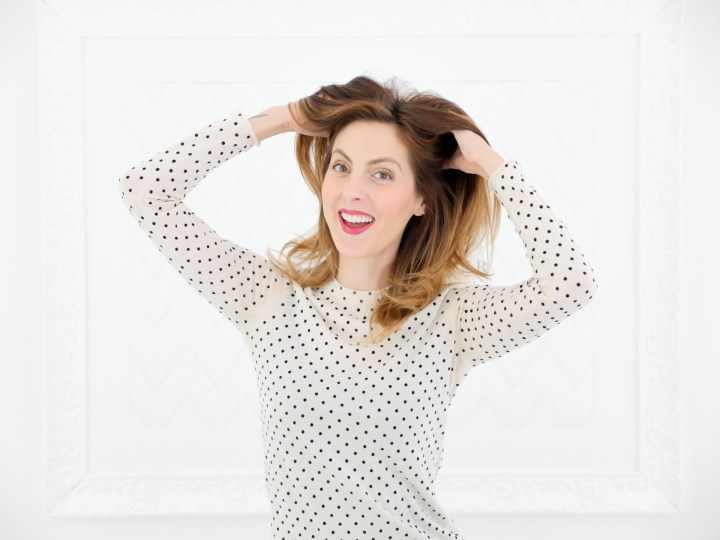 Eva Amurri Martino applies dry shampoo to her blowout as part of her monthly obsessions product roundup