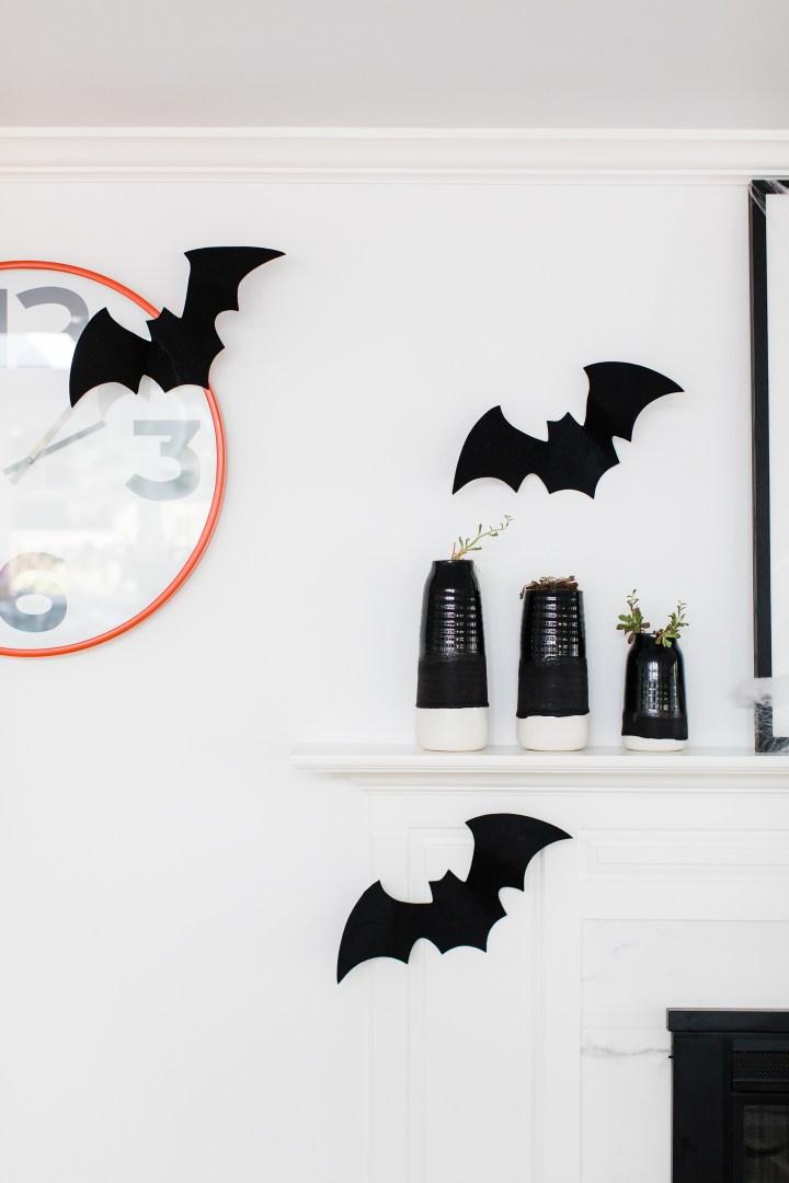 Felt bats fly around an orange clock in Eva Amurri Martino's Halloween decorated kitchen