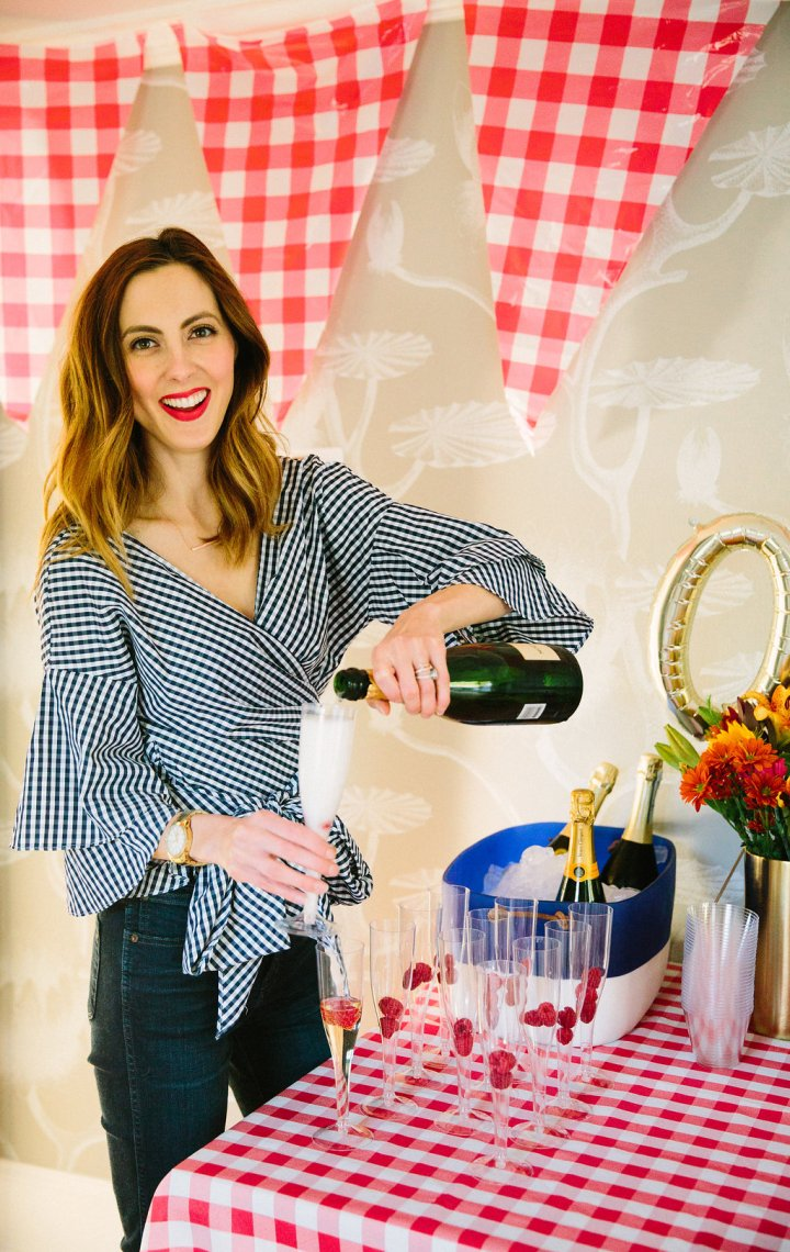 Eva Amurri Martino pours a glass of champagne at her son's first birthday party