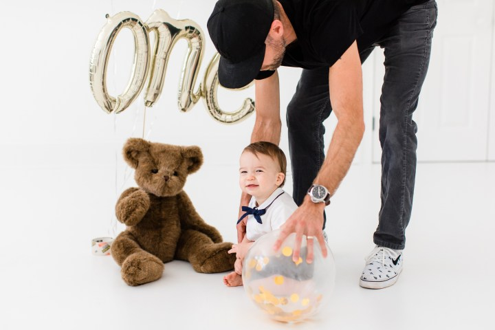 Kyle Martino helps his son Major sit for his first birthday portraits