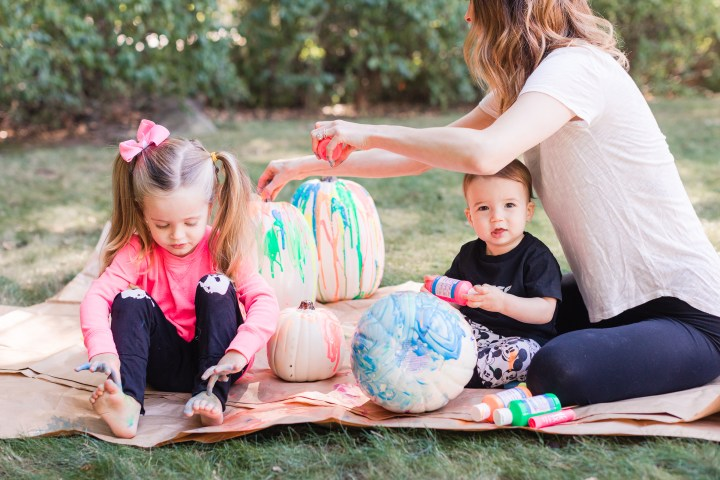Eva Amurri Martino and her two children Marlowe and Major create DIY technicolor pumpkins for the Halloween season