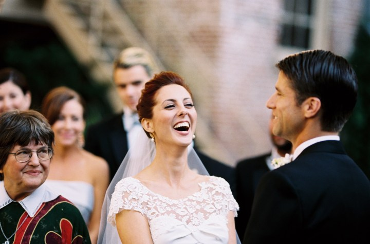 Eva Amurri Martino and Kyle Martino laugh together at the altar on their wedding day