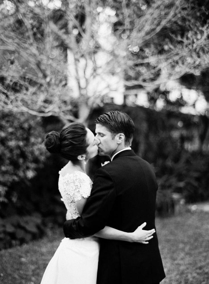 Eva Amurri Martino and Kyle Martino share a kiss in the courtyard on their weddding day in Charleston South Carolina
