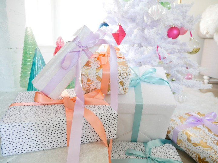 Eva Amurri Martino shares a selection of colorfully wrapped presents as a part of her holiday gift guides