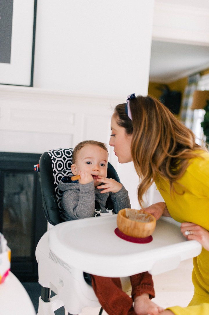 Eva Amurri Martino leans in to kiss son Major in his high chair in the kitchen of her Connecticut home