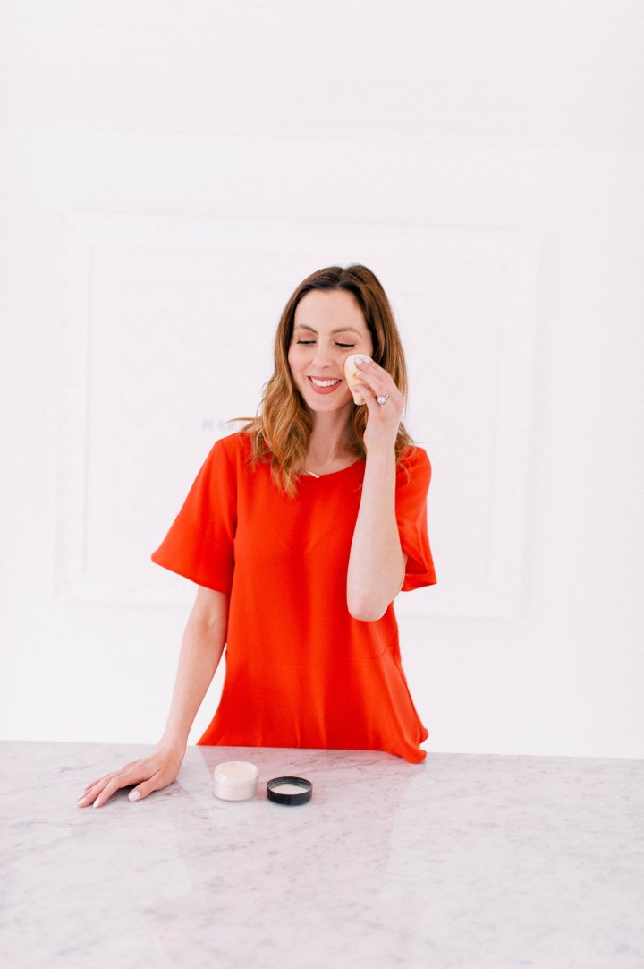 Eva Amurri Martino applies a laura mercier translucent setting powder to set her makeup for the day