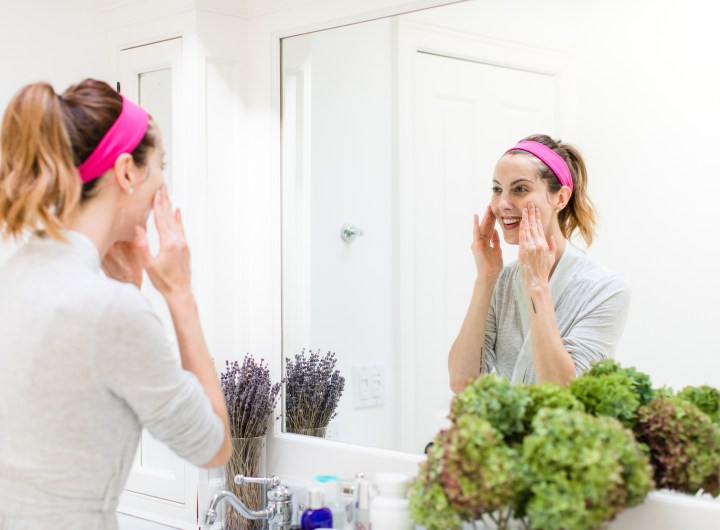 Eva Amurri Martino washes her face in the bathroom of her Connecticut home