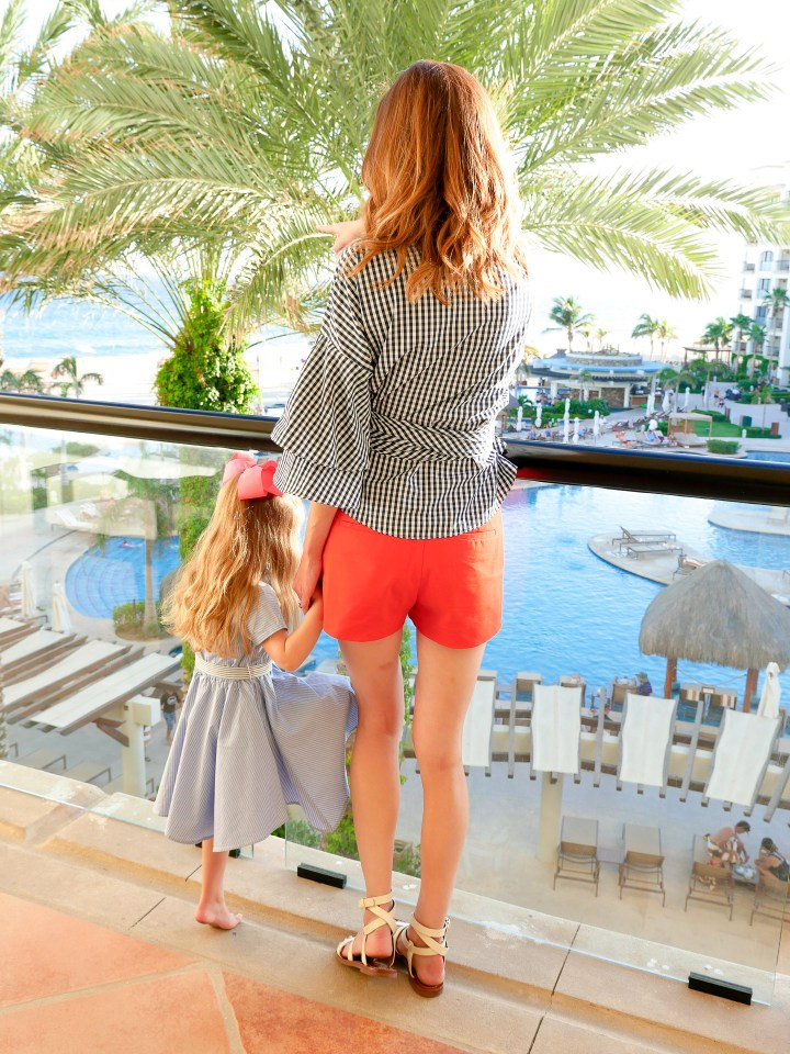Eva Amurri Martino and three year old daughter, Marlowe, stand on the balcony overlooking the ocean at the Hyatt Ziva Resort in mexico