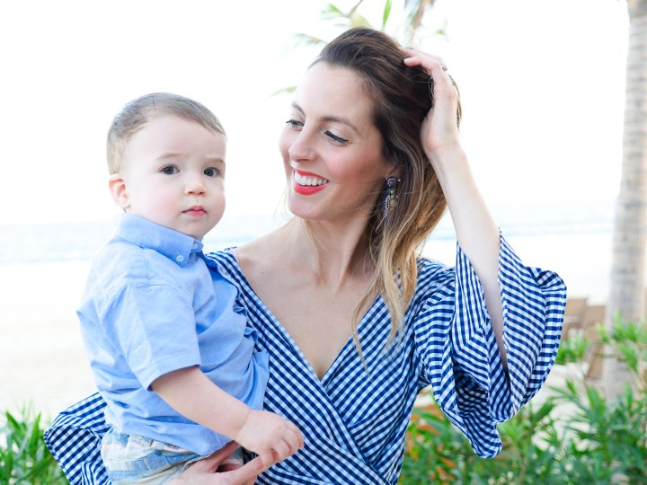 Eva Amurri Martino holds one year old son, Major, on the grounds of the Hyatt Ziva resort in los cabos, Mexico