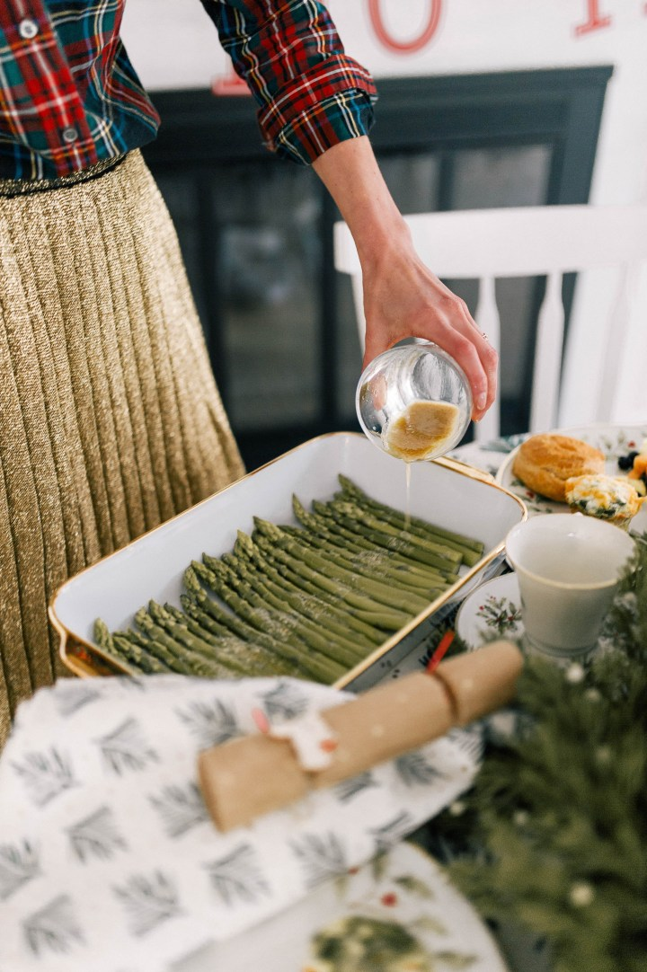 Eva Amurri Martino pours a lemony mustard vinaigrette over poached asparagus spears