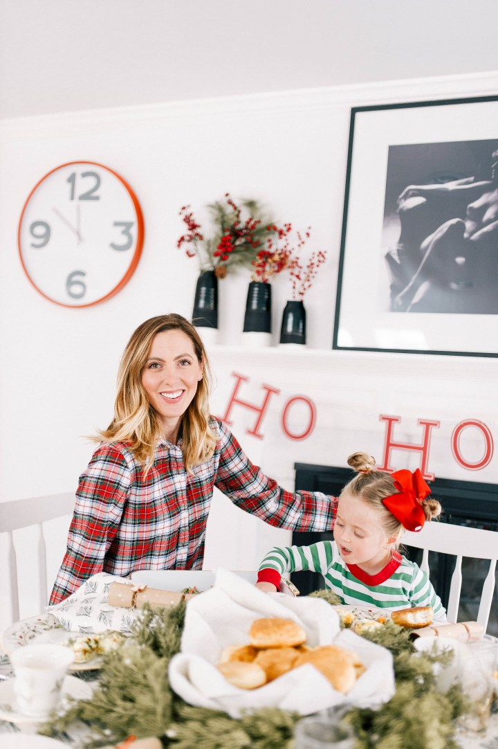 Eva Amurri Martino sits on the table to enjoy a festive christmas day brunch with her family at home in Connecticut