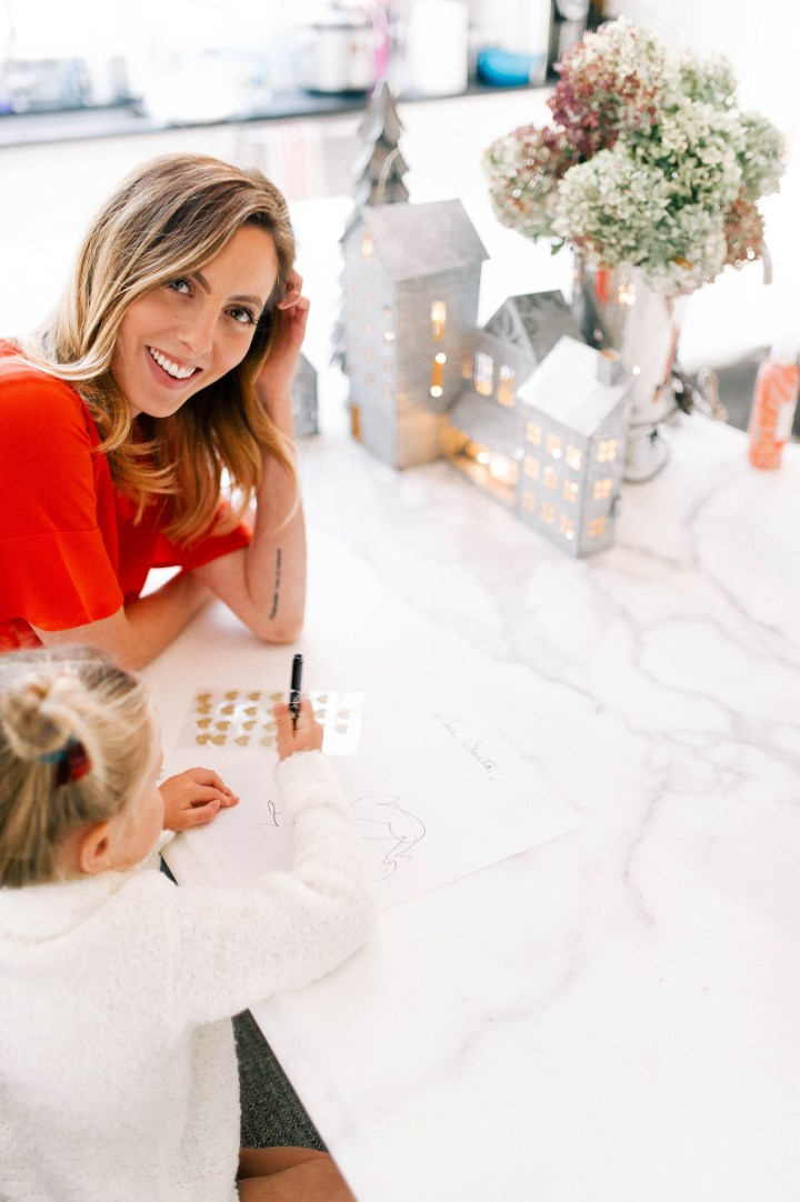 Eva Amurri Martino helps three year old daughter, Marlowe write a letter to santa