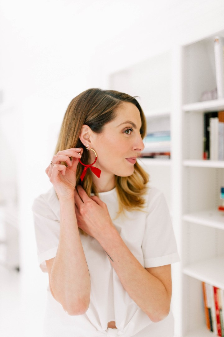Eva Amurri Martino wears a pair of red ribbon wrapped hoop earrings as part of her monthly obsessions post