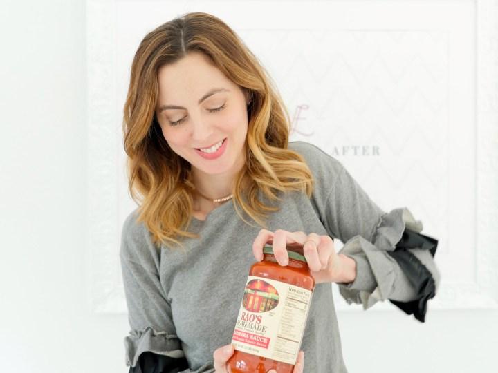 Eva Amurri Martino opens a can of pasta sauce