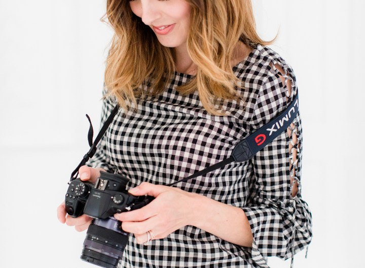 Eva Amurri Martino checks out the photos taken on her DLSR camera