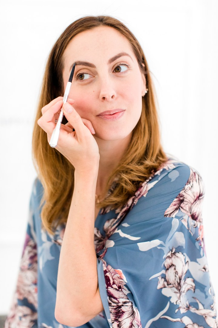 Eva Amurri Martino fills in her eyebrows with brow pencil as part of her photo shoot makeup tutorial