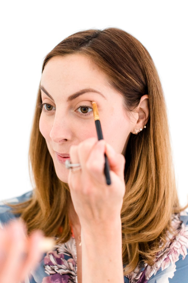 Eva Amurri Martino applies eyeshadow in to the crease of her eyelid