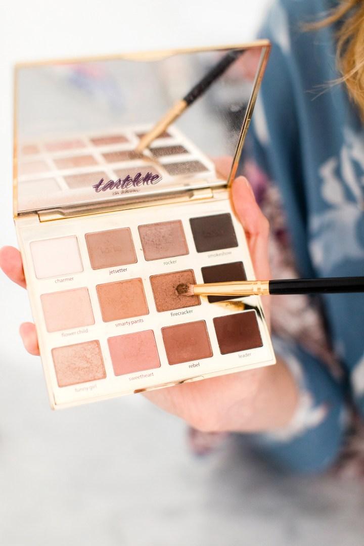 Eva Amurri Martino selects an eyeshadow for her makeup tutorial