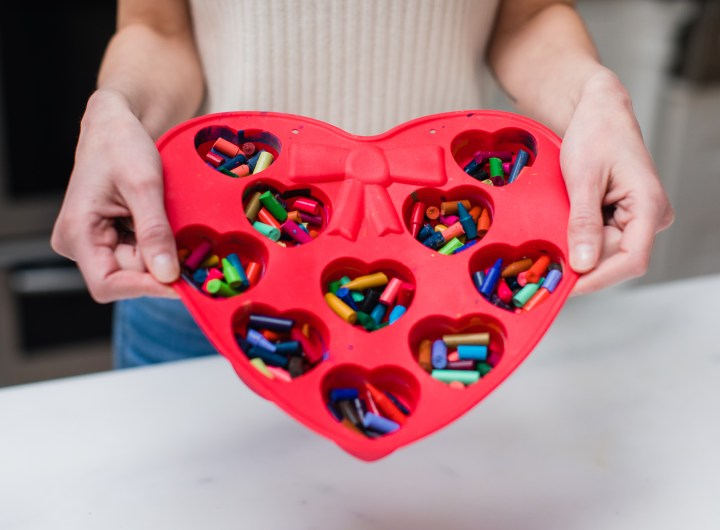 Eva Amurri Martino prepares to make crayon hearts out of bits of broken crayons in a heart mold