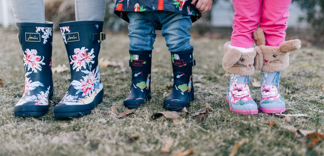 Eva Amurri Martino and her two small children wear patterned rain boots outside their Connecticut home