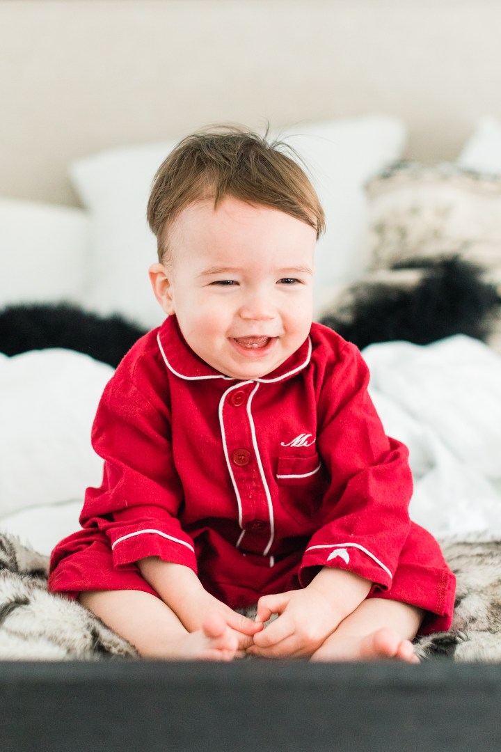 Major Martino laughs in bed at home in Connecticut wearing red flannel pajamas for Valentine's day