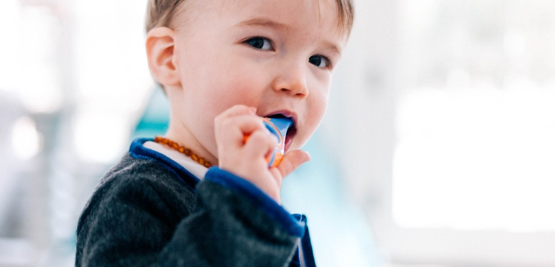 Major Martino wears a grey mohair suit and brushes his few teeth with a baby tooth brush in the family room of his Connecticut home