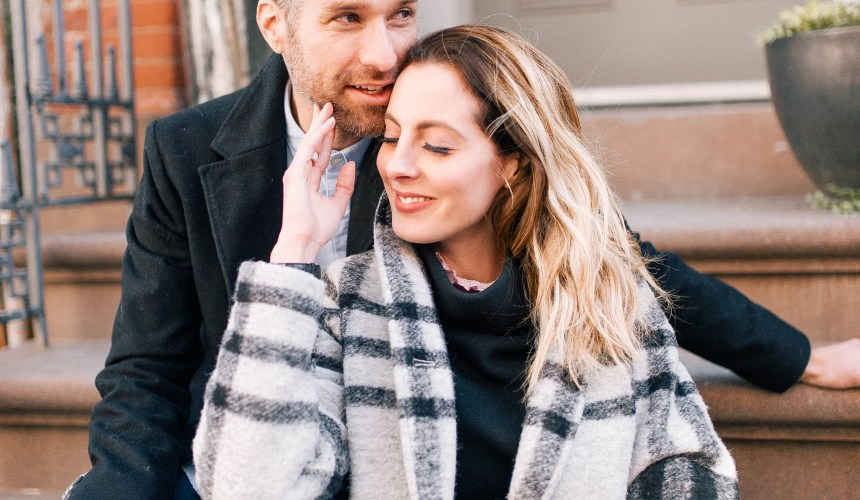 Eva Amurri Martino sits on a stoop with her husband Kyle