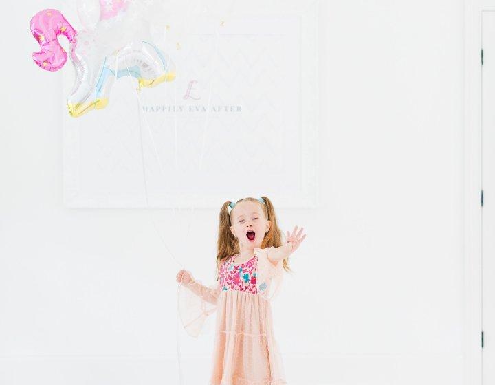Eva Amurri Martino's daughter Marlowe holds a unicorn balloon for her 4th birthday