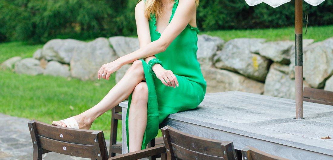 Eva Amurri Martino wears a bright green dress outside her home in Connecticut.