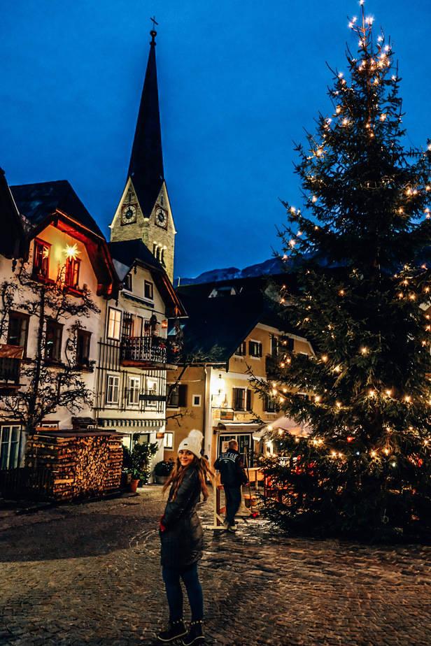 girl in Hallstatt Austria with Christmas lights