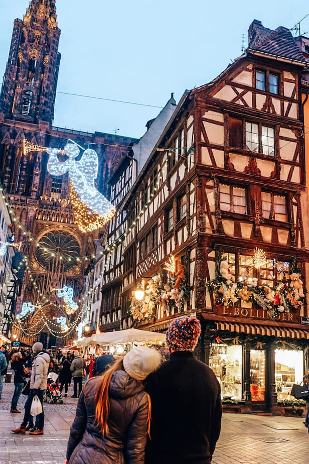 couple standing in front of Christmas decorations in Munich, Germany