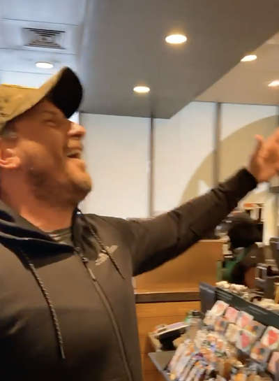 Customers sing along with Opera singing barista Jason