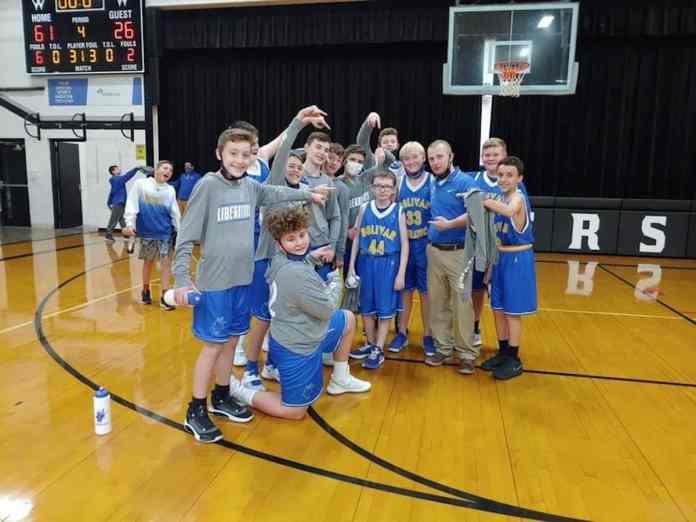Landon and his basketball team the Bolivar Liberators