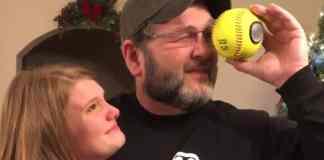 dad looks into softball at photos