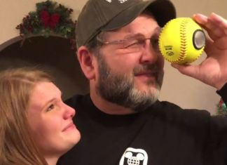dad looks into softball at photos