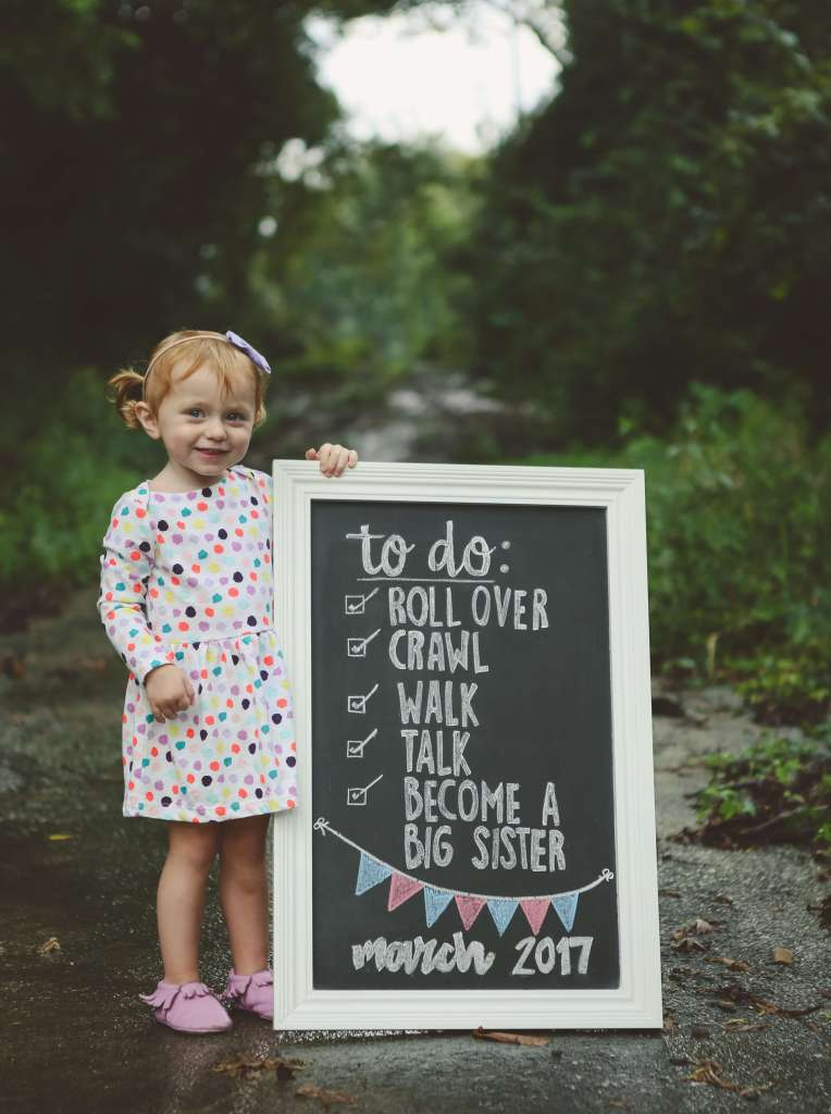 chalkboard baby announcement with toddler