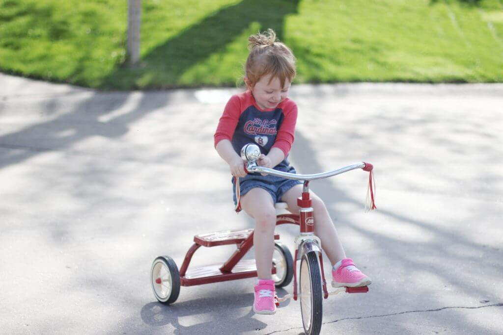 Blaire riding Tricycle