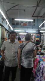 Busy day inside the cloth market.